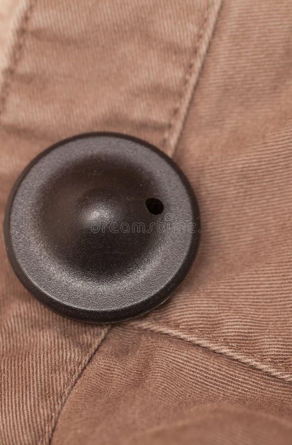 Etiqueta da segurança da roupa fotos de stock
