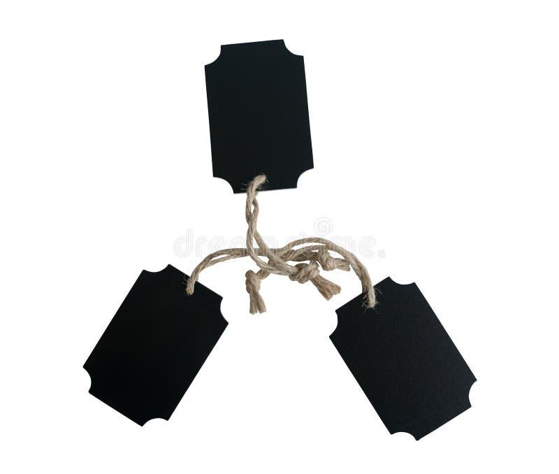 Etiqueta de madeira do preto de três placas amarrada com corda marrom foto de stock