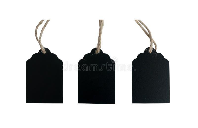 Etiqueta de madeira do preto de três placas e corda marrom fotografia de stock royalty free