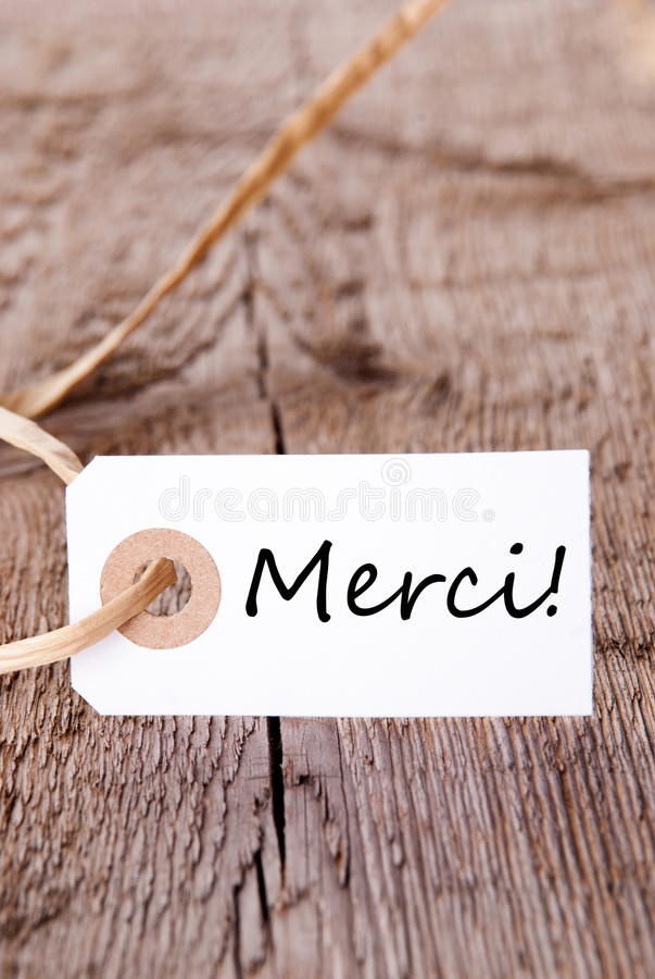 Etiqueta de Merci na madeira imagem de stock