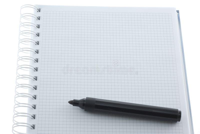 Etiqueta de plástico en el cuaderno imagen de archivo