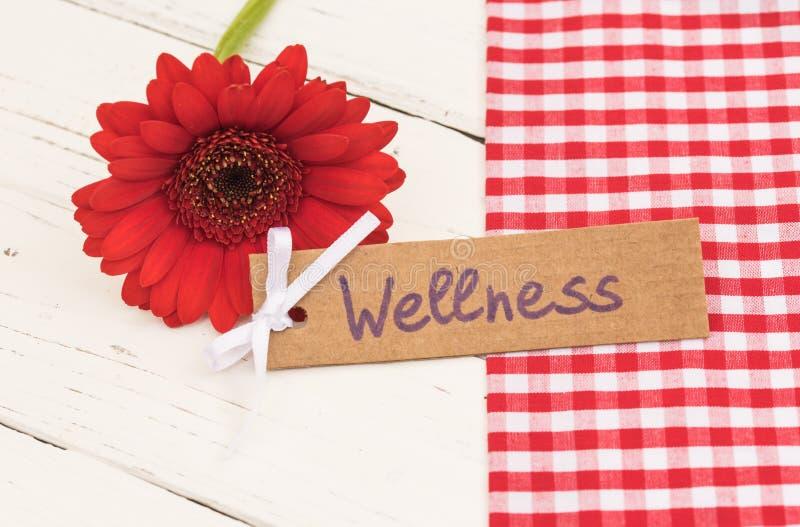 Etiqueta del regalo de la salud con la flor roja como regalo para el día de las tarjetas del día de San Valentín o de madres foto de archivo libre de regalías