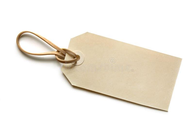 Etiqueta en blanco con la venda de elástico imagen de archivo