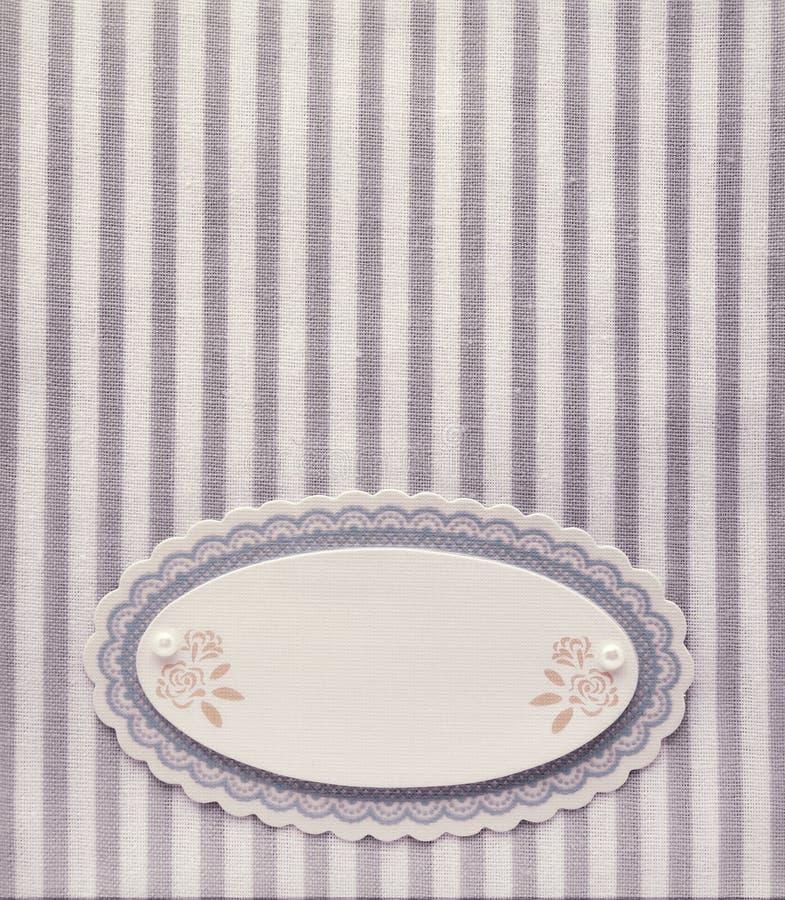 Etiqueta en blanco de papel del vintage en fondo retro del modelo rayado del estilo fotos de archivo libres de regalías