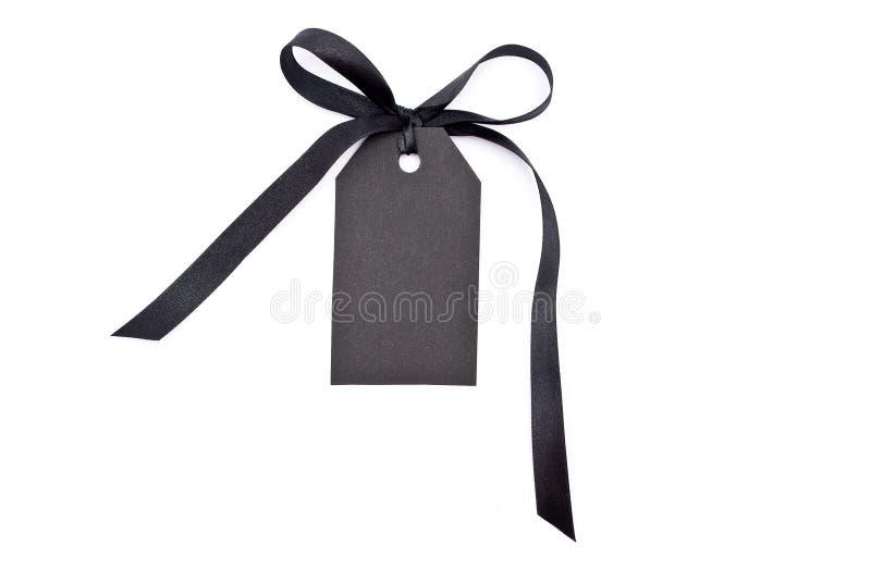 Etiqueta negra del regalo imagen de archivo