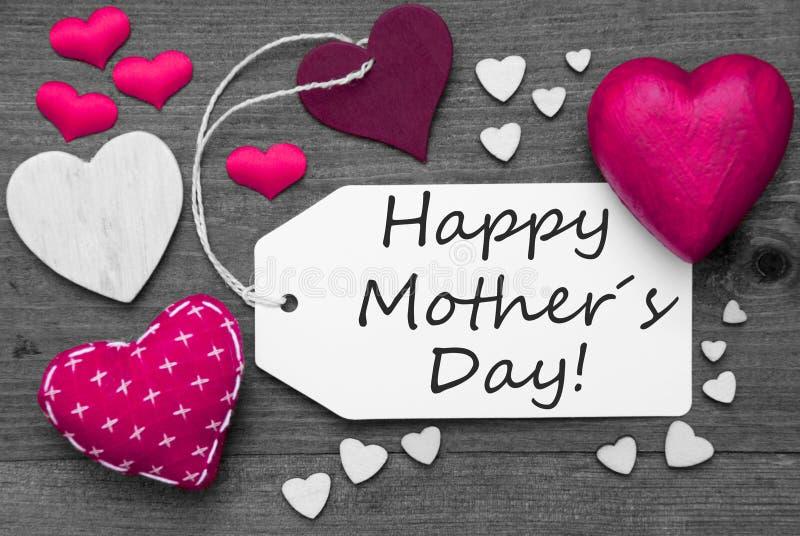 A etiqueta preto e branco, corações cor-de-rosa, Text o dia de mães feliz imagens de stock royalty free