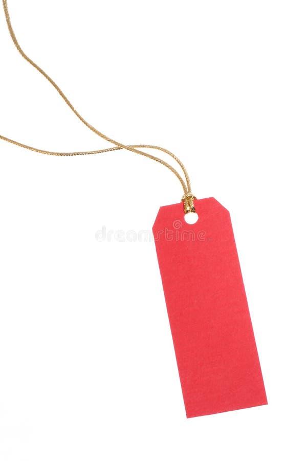 Etiqueta roja del regalo imagenes de archivo