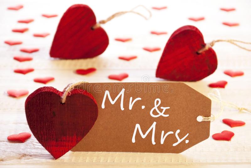 Etiqueta romântica com corações, Sr. do texto e da Sra imagens de stock royalty free