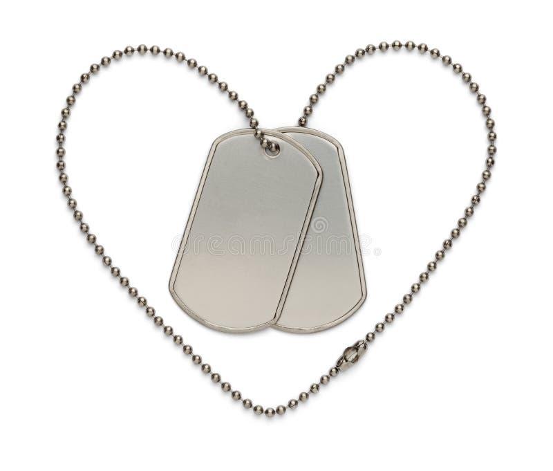 Etiquetas de cão militares do coração imagem de stock