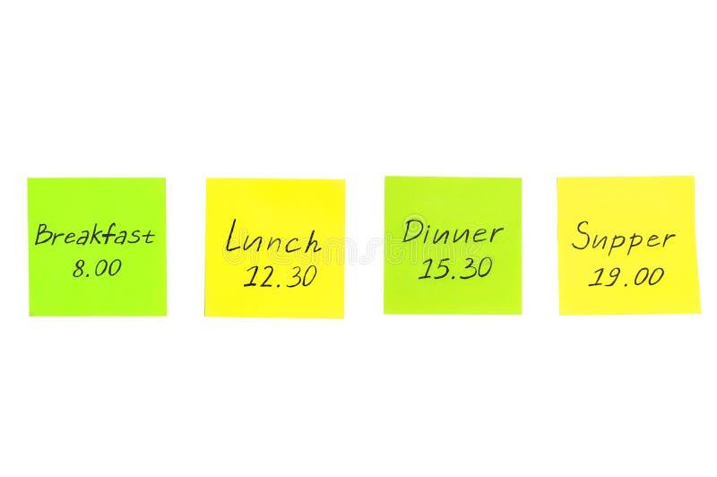 Etiquetas engomadas multicoloras con las notas Desayuno, almuerzo, cena imagen de archivo libre de regalías
