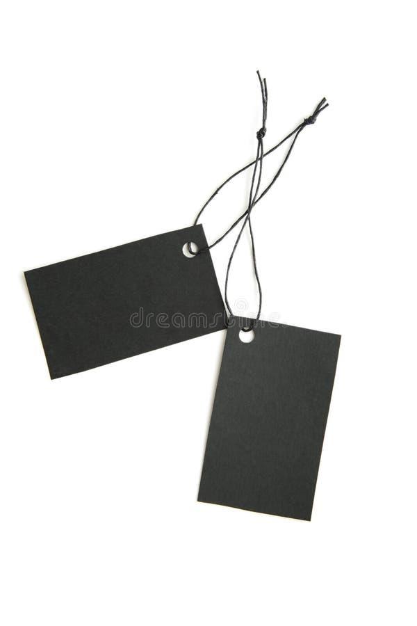 Etiquetas negras de la venta foto de archivo