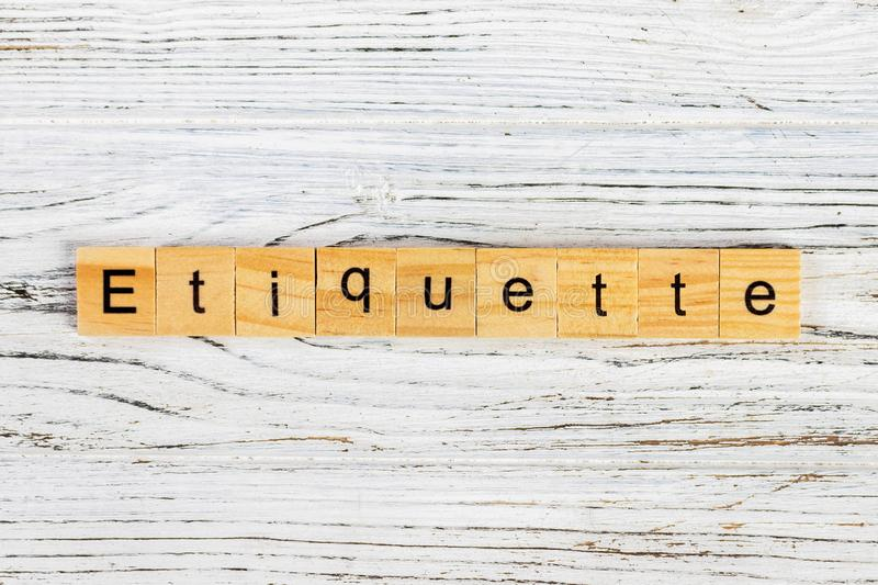Etiquette word made with wooden blocks concept.  royalty free stock photography
