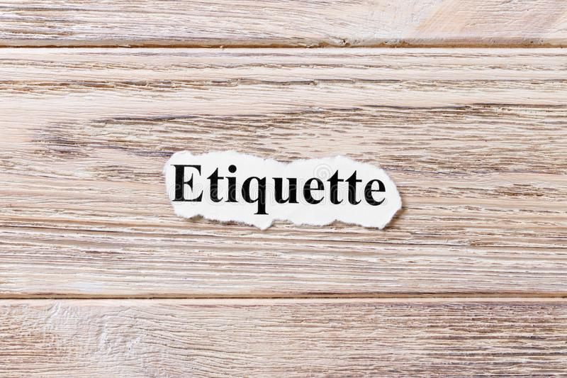 Etiquette of the word on paper. concept. Words of etiquette on a wooden background.  royalty free stock image