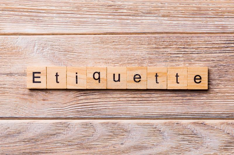 ETIQUETTE word written on wood block. ETIQUETTE text on wooden table for your desing, concept.  royalty free stock photo
