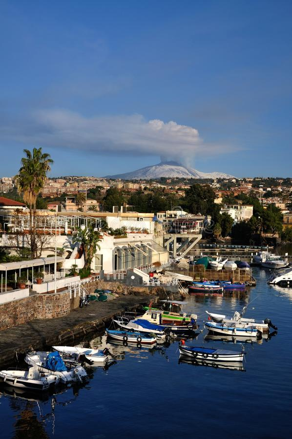 Etna eruption from harbour stock images