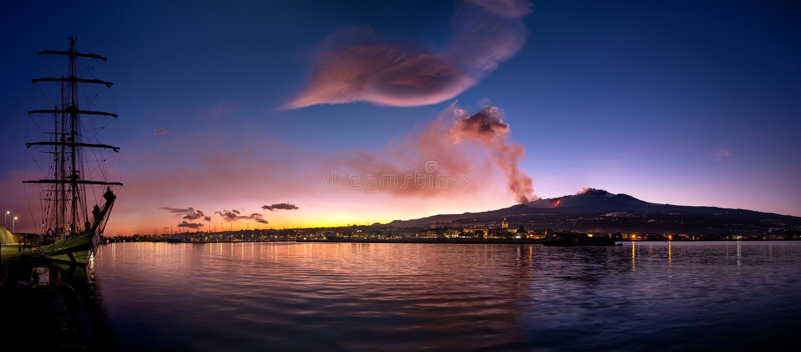 Etna eruption viewed from the sea stock image