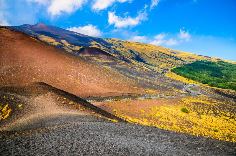Etna national park landscape, Catania, Sicily. Long road in the middle of volcanic national park of Etna stock photography
