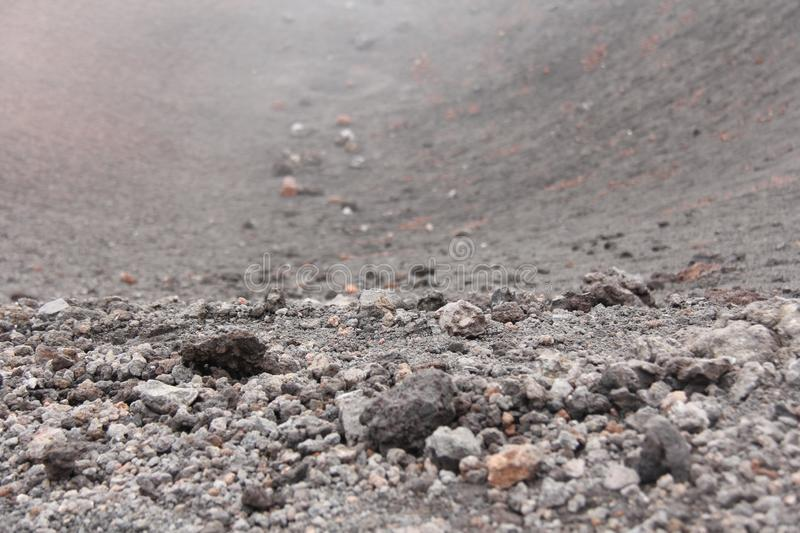 The Etna Volcano. Black Volcanic Earth, Volcanic Lava and Stones. Dense Fog on Mount Etna. Place for Text. The island of Sicily, stock image