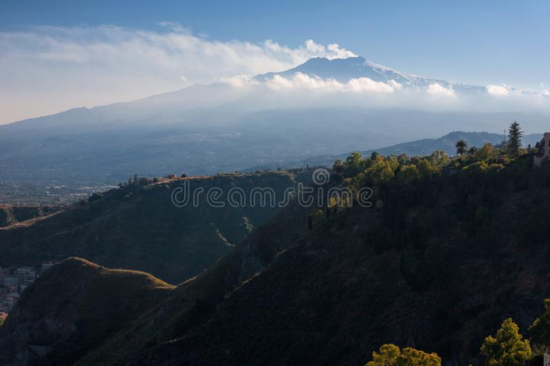 Etna Volcano and hills in the fron in backlight from Taormina in. Sicily, Italy stock images