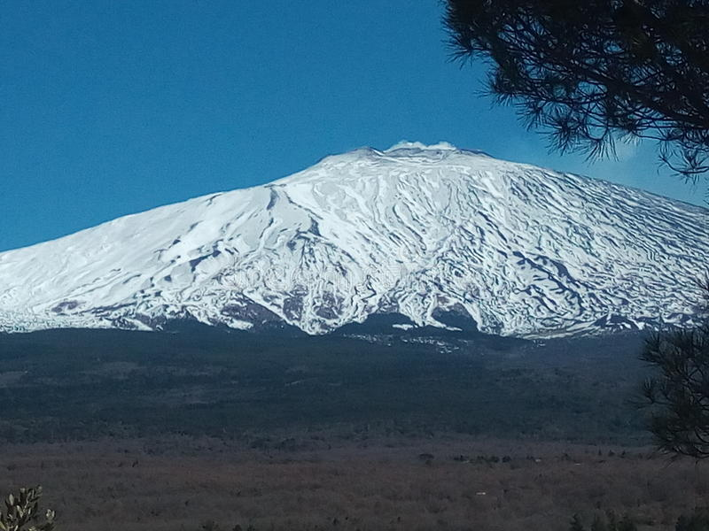 Etna in white fur coat stock photos