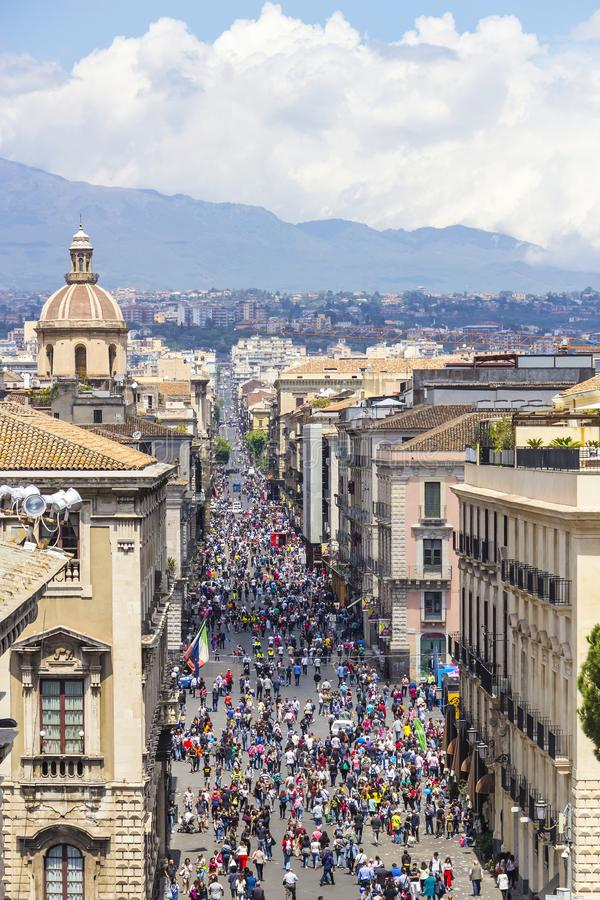 Etnea street, Catania, Sicily, Italy. CATANIA, ITALY - MAY 8, 2018: People walk on Via Etnea central street of Catania with the view on Etna volcano stock images