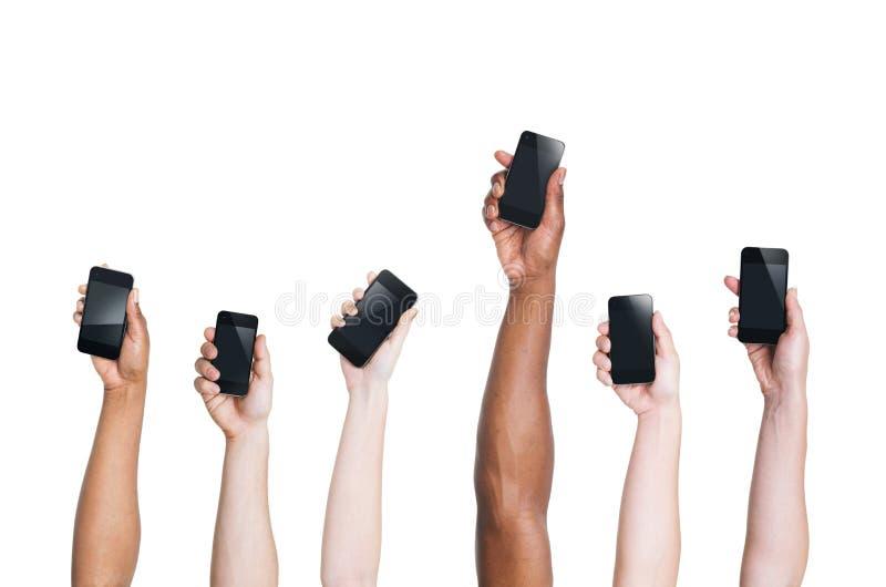 etniczne ręki Podnosi Smartphones i Jeden pozycję Out zdjęcia stock