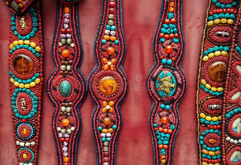 Etniska tibetana bälten arkivbilder