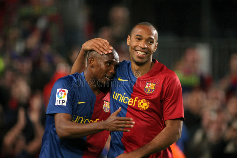 Eto'o ad Henry celebrates goal. BARCELONA - MARCH 22: Samuel Eto'o and Thierry Henry of FC Barcelona celebrates a goal in spanish soccer league match March 22 stock photos