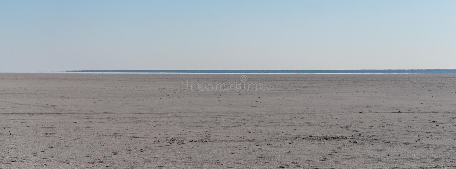 The Etosha Salt Pan. An overview of the empty space of the Etosha salt pan, Ethosha National Park, Namibia royalty free stock photos
