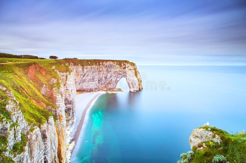 Etretat, Manneporte natural rock arch and its beach. Normandy, F. Etretat, la Manneporte natural rock arch wonder, cliff and beach. Long exposure photography stock images