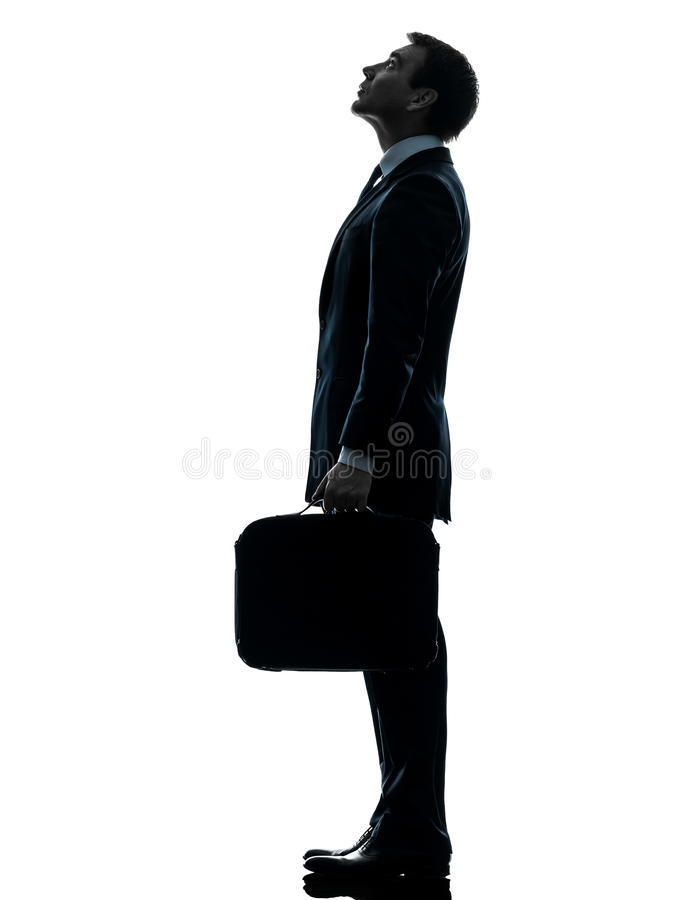 Affärsmananseende som upp ser silhouetten royaltyfri foto