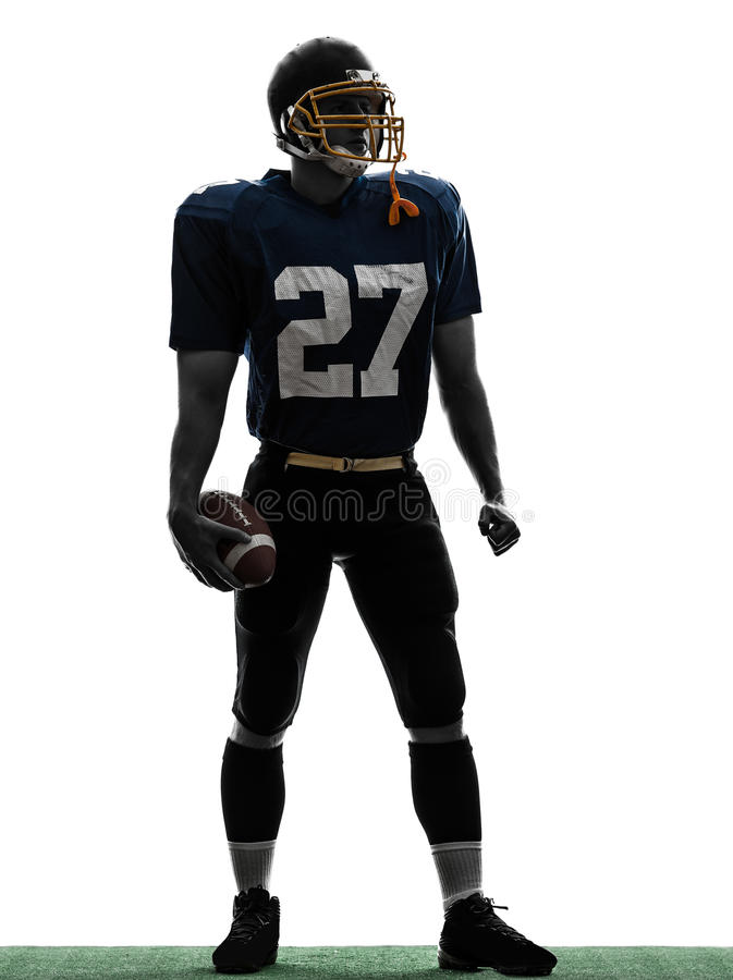 Silhouette för man för Quarterbackamerikanfotbollsspelare stå royaltyfria bilder