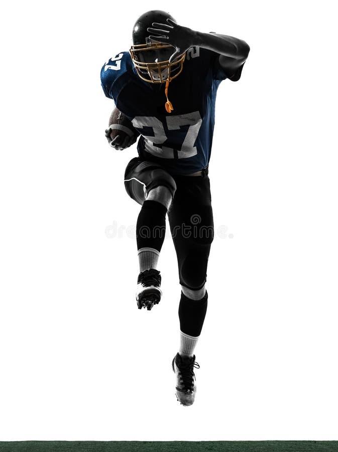 Silhouette för spring för amerikanfotbollsspelareman royaltyfri foto