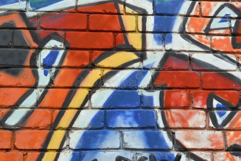 Ett fragment av modellen på tegelstenväggen, grafitti royaltyfri foto