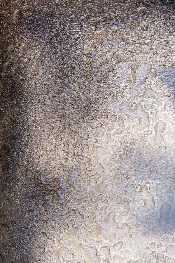 Ett gammalt guld- piskar textur med droppar royaltyfri foto