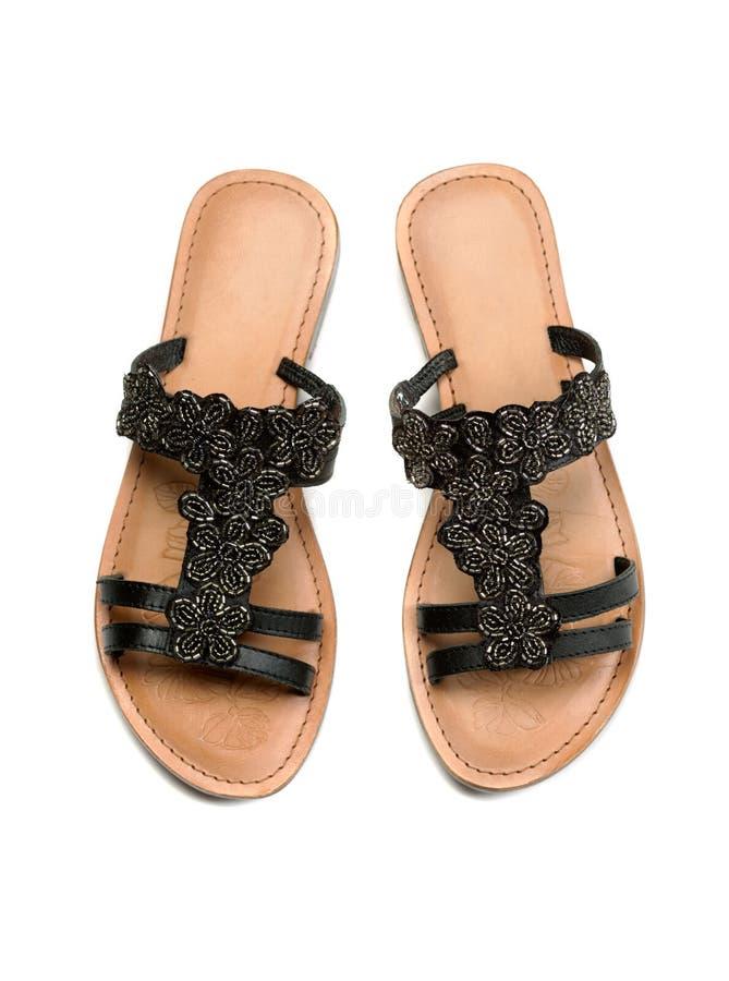 Ett par av läderkvinnors sandaler Top beskådar arkivfoton