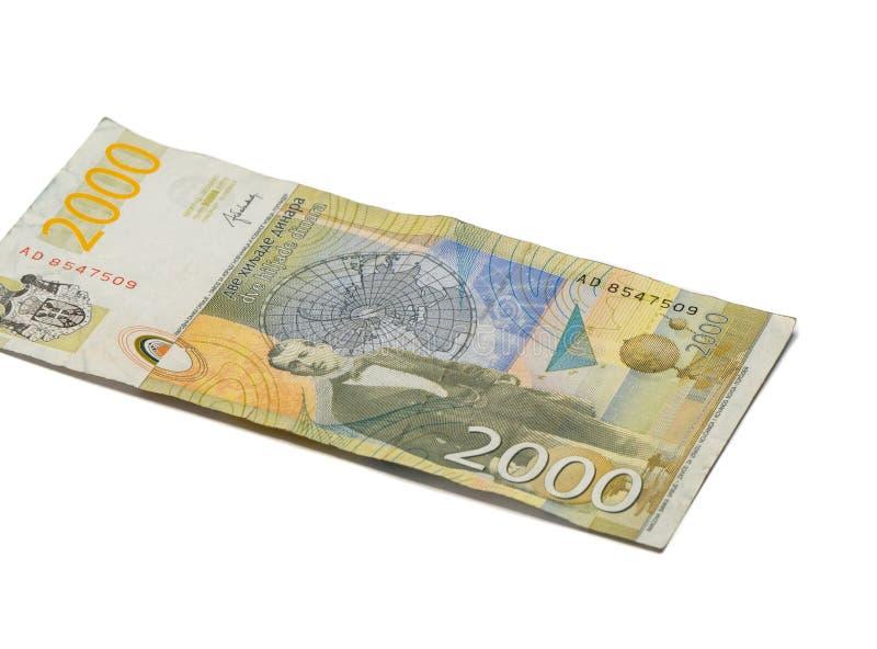 Ett sedelvärde 2000 serbiska dinar med en stående av en klimatforskare Milutin Milankovic isolerade på en vit bakgrund royaltyfri fotografi