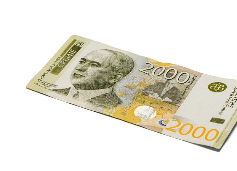 Ett sedelvärde 2000 serbiska dinar med en stående av en klimatforskare Milutin Milankovic isolerade på en vit bakgrund fotografering för bildbyråer