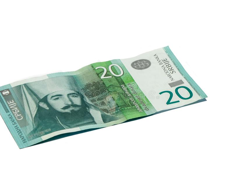 Ett sedelvärde 20 serbiska dinar med en stående av linjalen av Montenegro Peter II Petrovich isolerade på en vit bakgrund royaltyfri bild