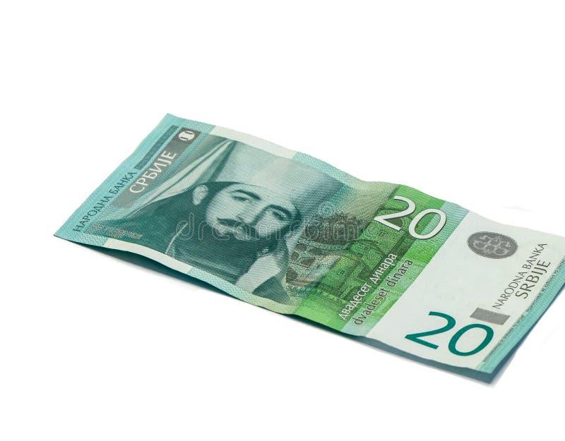 Ett sedelvärde 20 serbiska dinar med en stående av linjalen av Montenegro Peter II Petrovich isolerade på en vit bakgrund royaltyfri foto