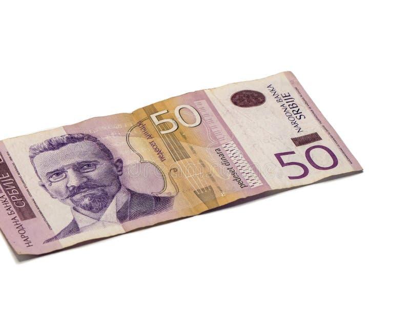 Ett sedelvärde 50 serbiska dinar med en stående av violinisten Stevan Mokranyats som isoleras på en vit bakgrund royaltyfri bild