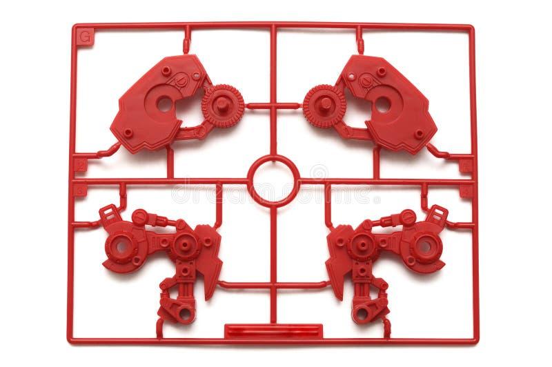 Ett stycke av den röda plast- uppsättningen för sats för skalamodell med futuristiska robotic delar arkivfoto