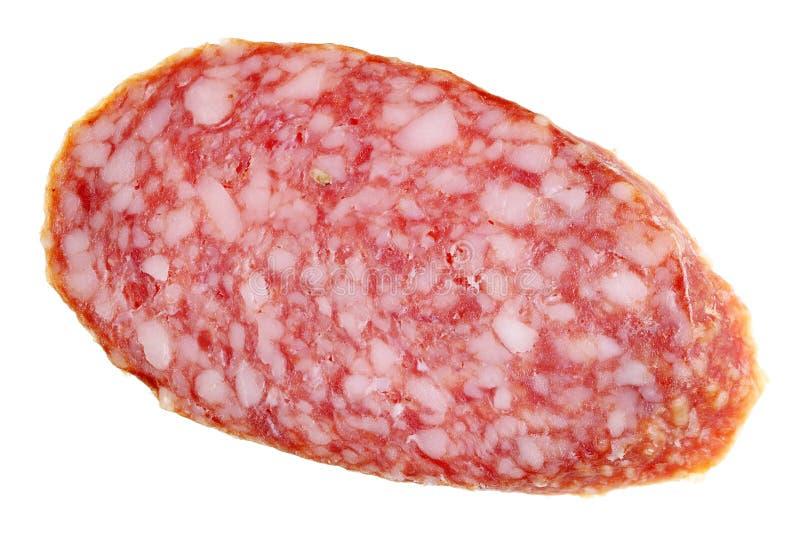 Ett stycke av fattig-kvalitet rökte korven med salami med mycket royaltyfria bilder