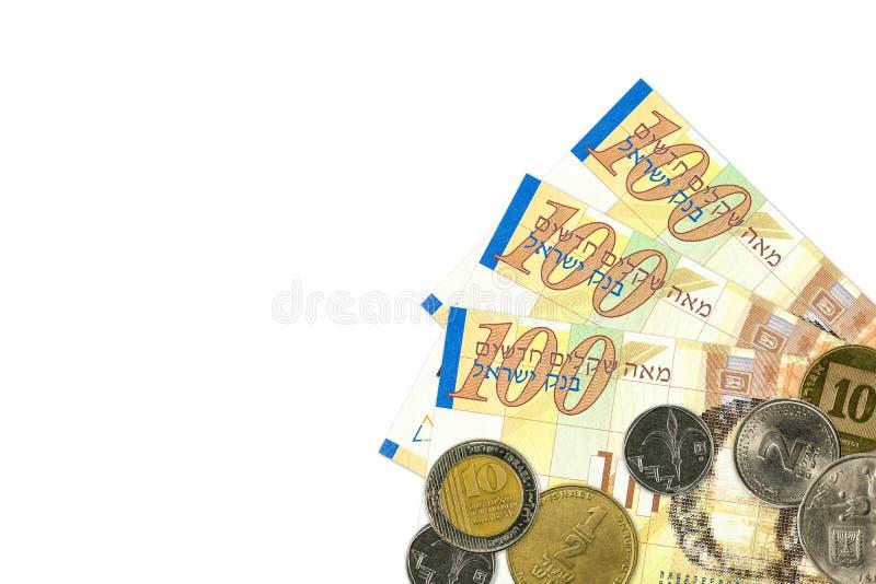 Etwa israelische 100 neue Schekelbanknoten und -münzen stockbild