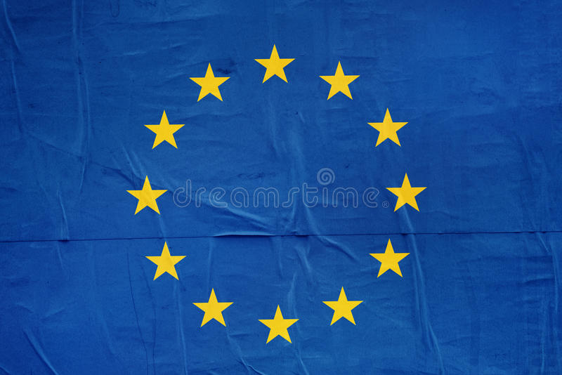 EU Flag Print on Grunge Poster Paper stock image