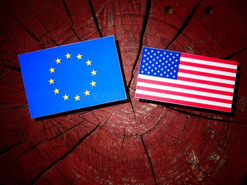 EU flag with USA flag on a tree stump royalty free stock image