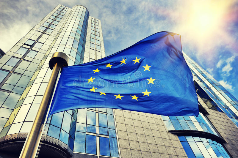 EU flag waving in front of European Parliament building in Bruss royalty free stock image