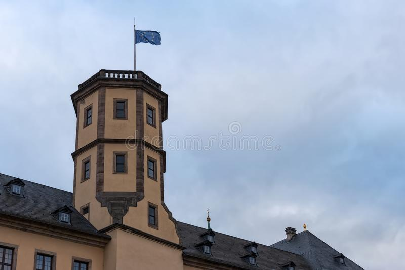 EU flag waving on the top of the Fulda castle-tower. Low angle view stock photo