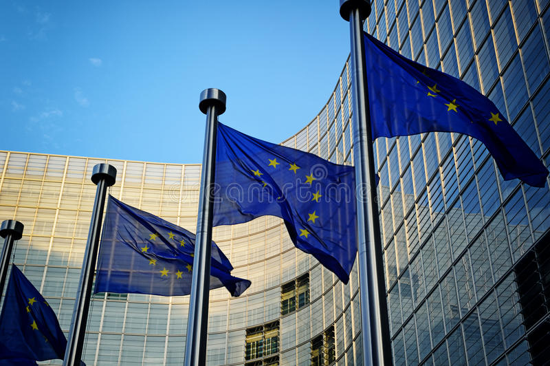 EU flags in front of European Commission. Building in Brussels royalty free stock photography