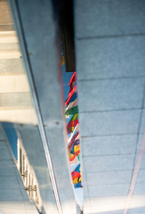 EU flags reflected in puddle royalty free stock photography